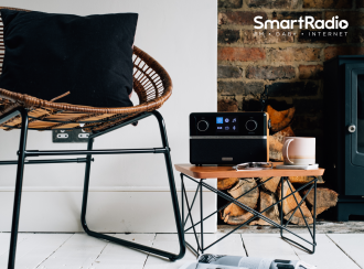 Stream 94i on a coffee table with Smart Radio logo