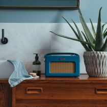 iStream 3 in Teal Blue next to bathroom sink and plant
